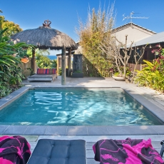 Relaxinlg by the pool, 22 McAnally Drive Sunshine Beachl